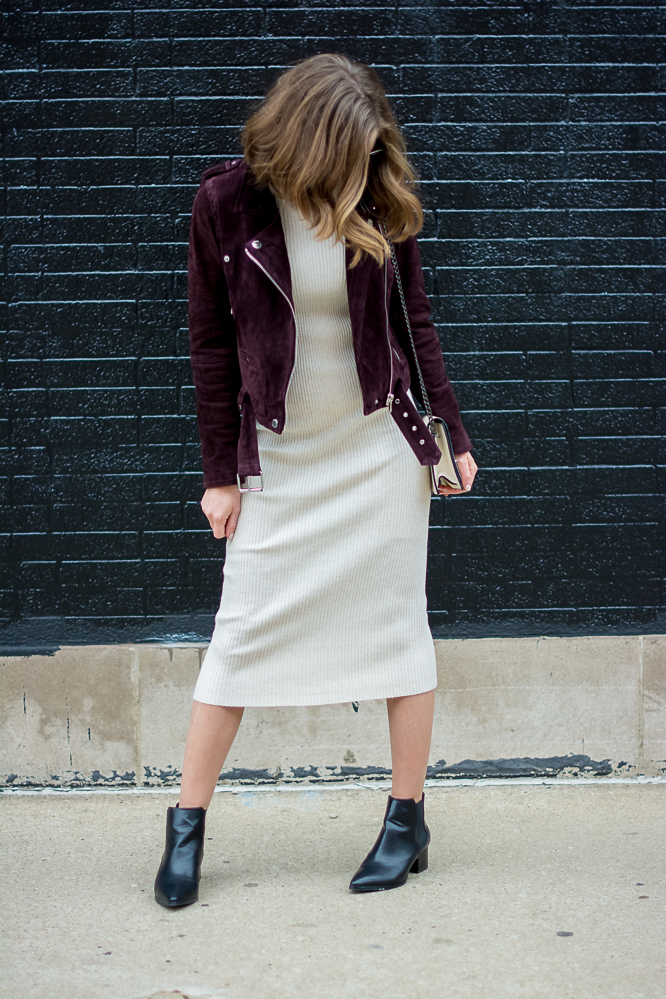edgy layers a bodycon midi dress and a suede moto