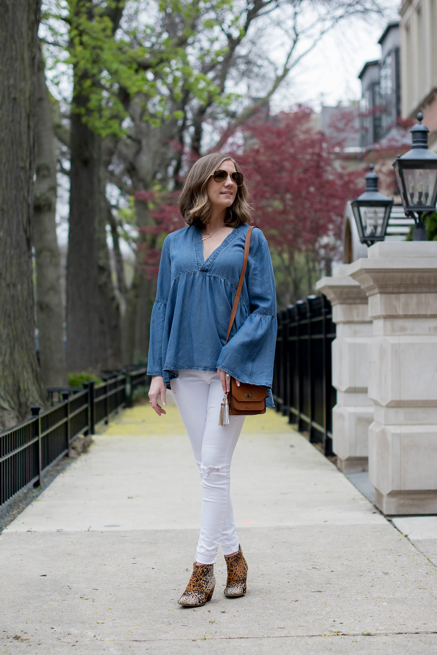 transitioning-white-jeans-for-fall-hm-denim-bell-sleeve-top-matisse-leopard-booties-metallic-bag-tassel-charms-3