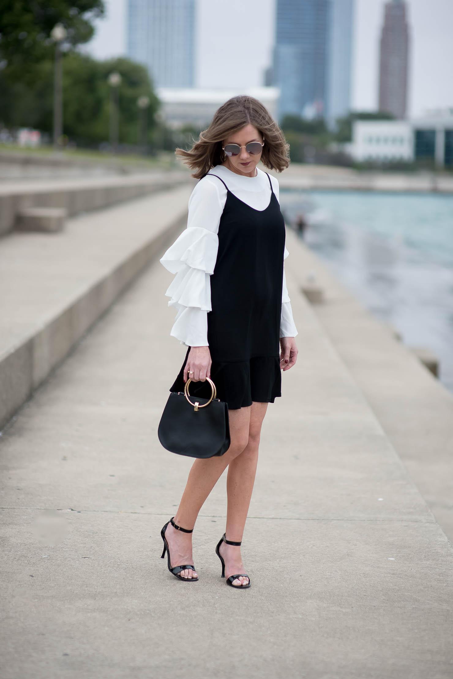 boohoo-ruffle-sleeve-blouse-asos-slip-dress-layered-ruffles-forever-21-round-handle-bag-black-and-cream