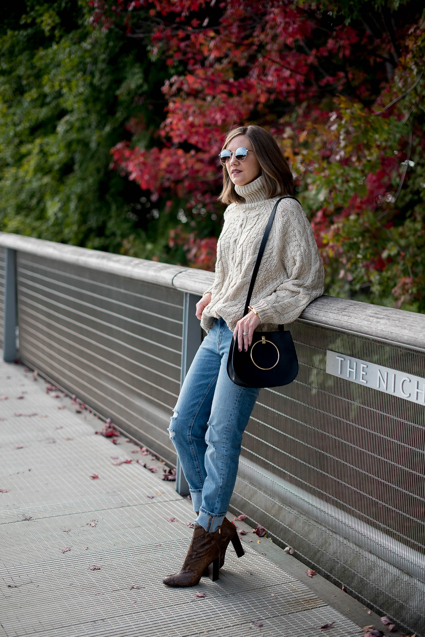 thanksgiving outfit idea fall in chicago hm cable oversized turtleneck sweater girlfriend jeans snakeskin boots how to wear over the ankle boots cozy fall style