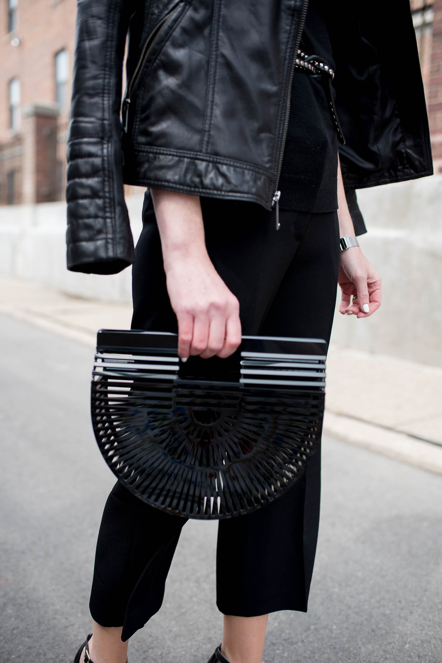 how to style black crop pants, culotte outfit idea, edgy spring outfit, black cult gaia arc clutch, the studded skinny belt, monochromatic outfit