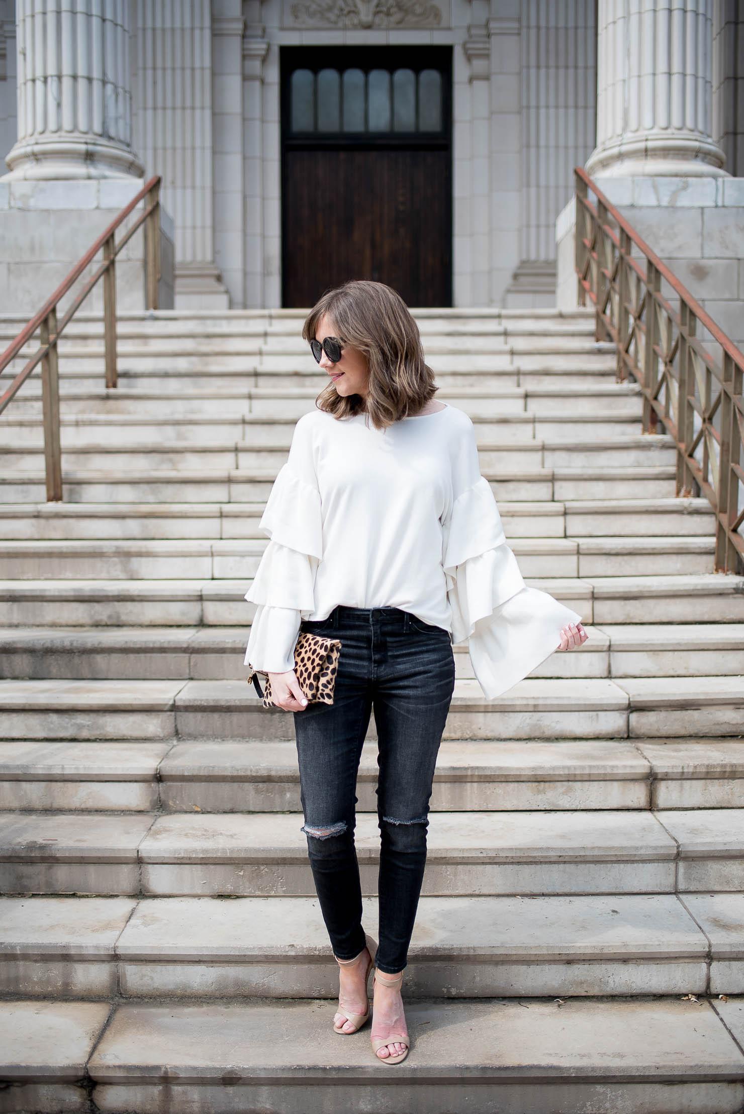 zara dramatic ruffle sleeve sweater, dark grey distressed jeans, leopard clutch, spring in chicago
