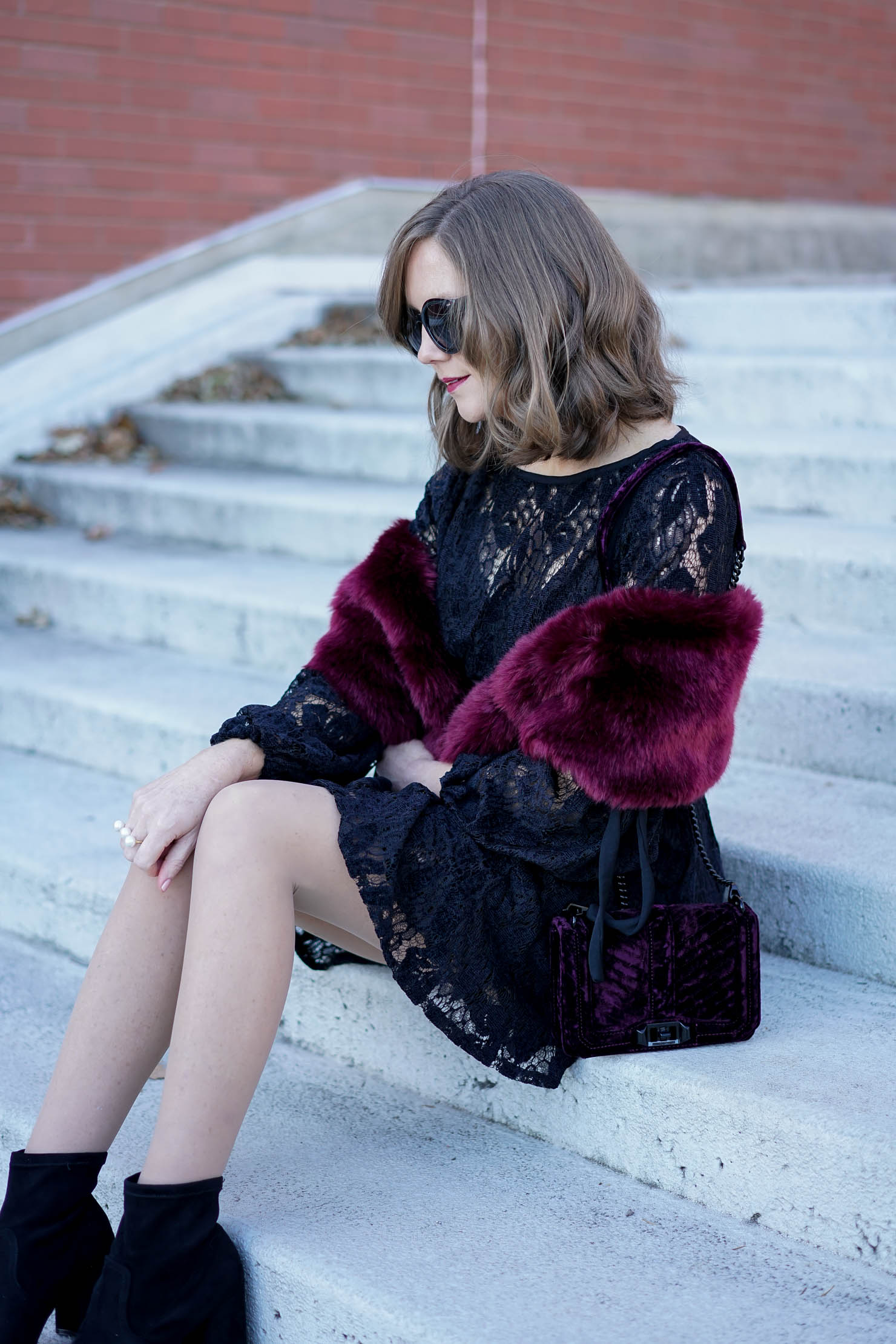 dressy holiday outfit, Free People black lace mini dress with long sleeves, holiday outfit, dressy holiday look, burgundy faux fur wrap, velvet crossbody, mixing lace velvet and fur textures