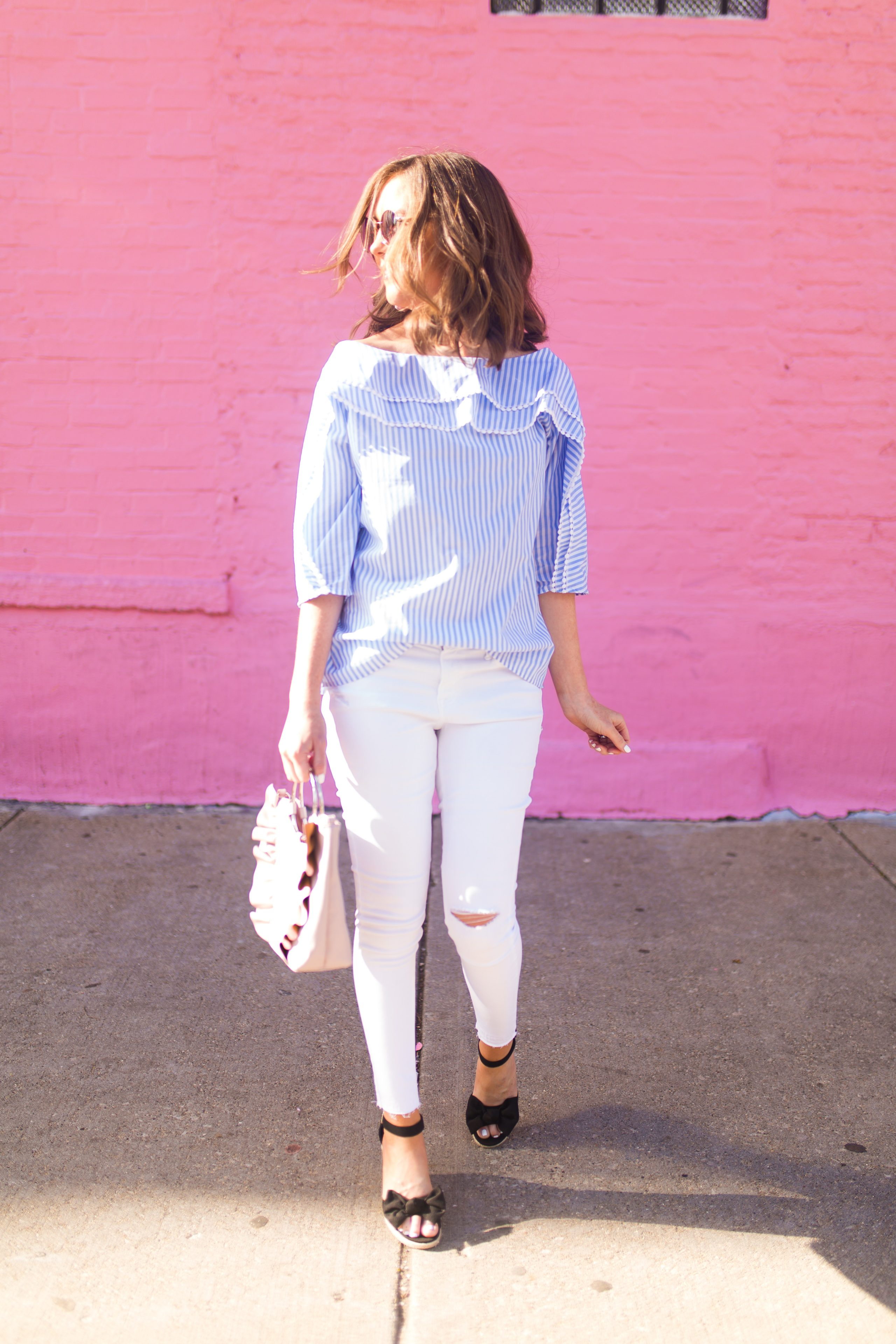 blue-white-pinstriped-off-the-shoulder-blouse-with mini-pompom-trim-pink-wall-chicago-bow-wedges-ruffled-pink bag-with-ring-handle