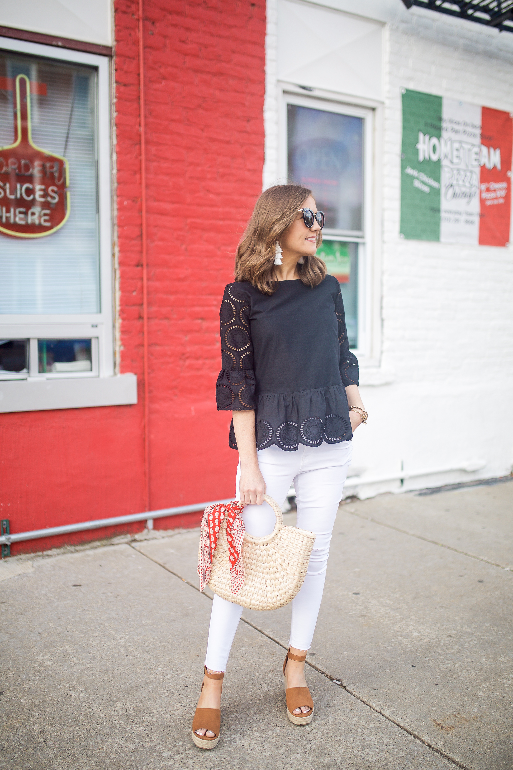 loft circle eyelet peplum blouse, black and white outfit, an easy summer date night outfit, red and white wall, tying a scarf on a handbag