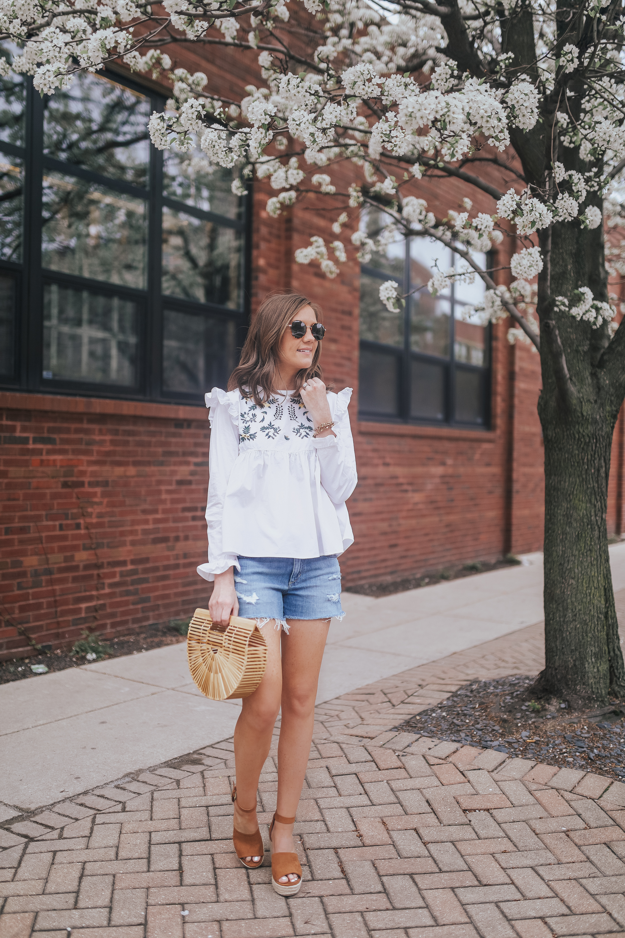 ruffled embroidered blouse, day to night summer outfit, dressing up cutoffs, summer fashion, how to take cutoffs from day to night