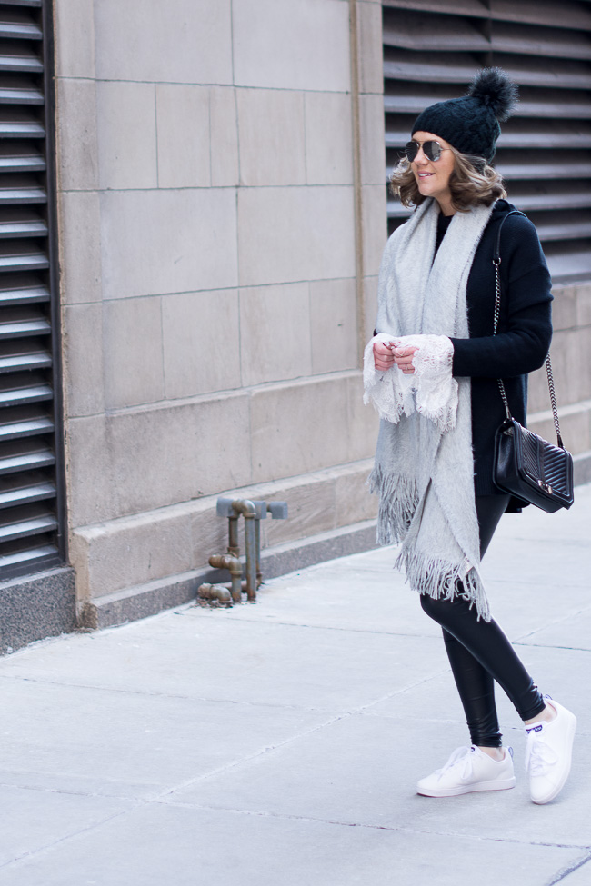 chic street style, cozy layers, black and white street style, quilted crossbody, adidas neo advantage sneakers, lace bell sleeved blouse
