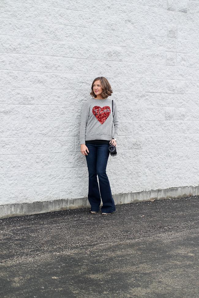 sequin sweater, flared jeans, leopard heels