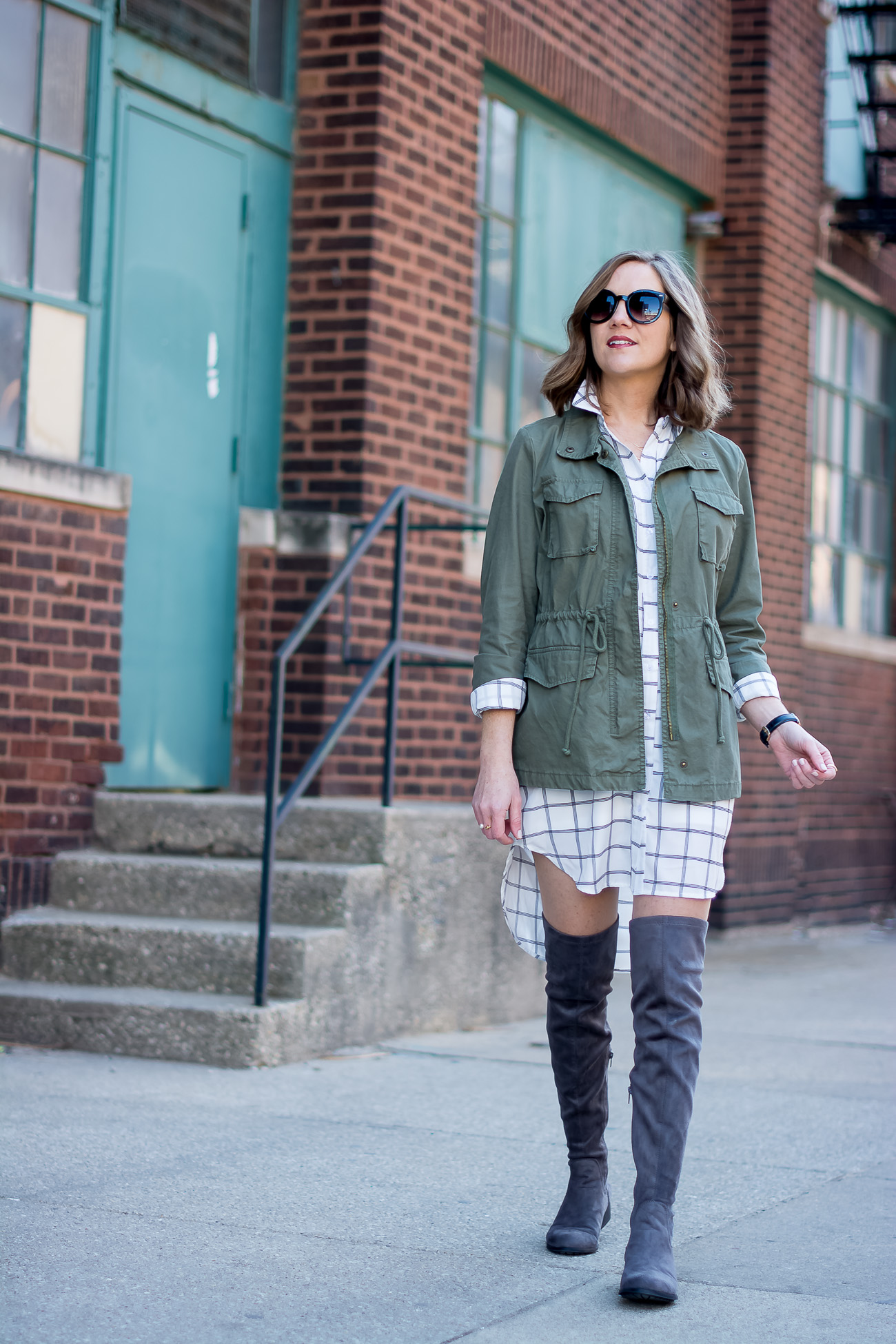 cargo-jacket-black-and-white-grid-print-shirtdress-gray-over-the-knee-boots-delicate-jewelry