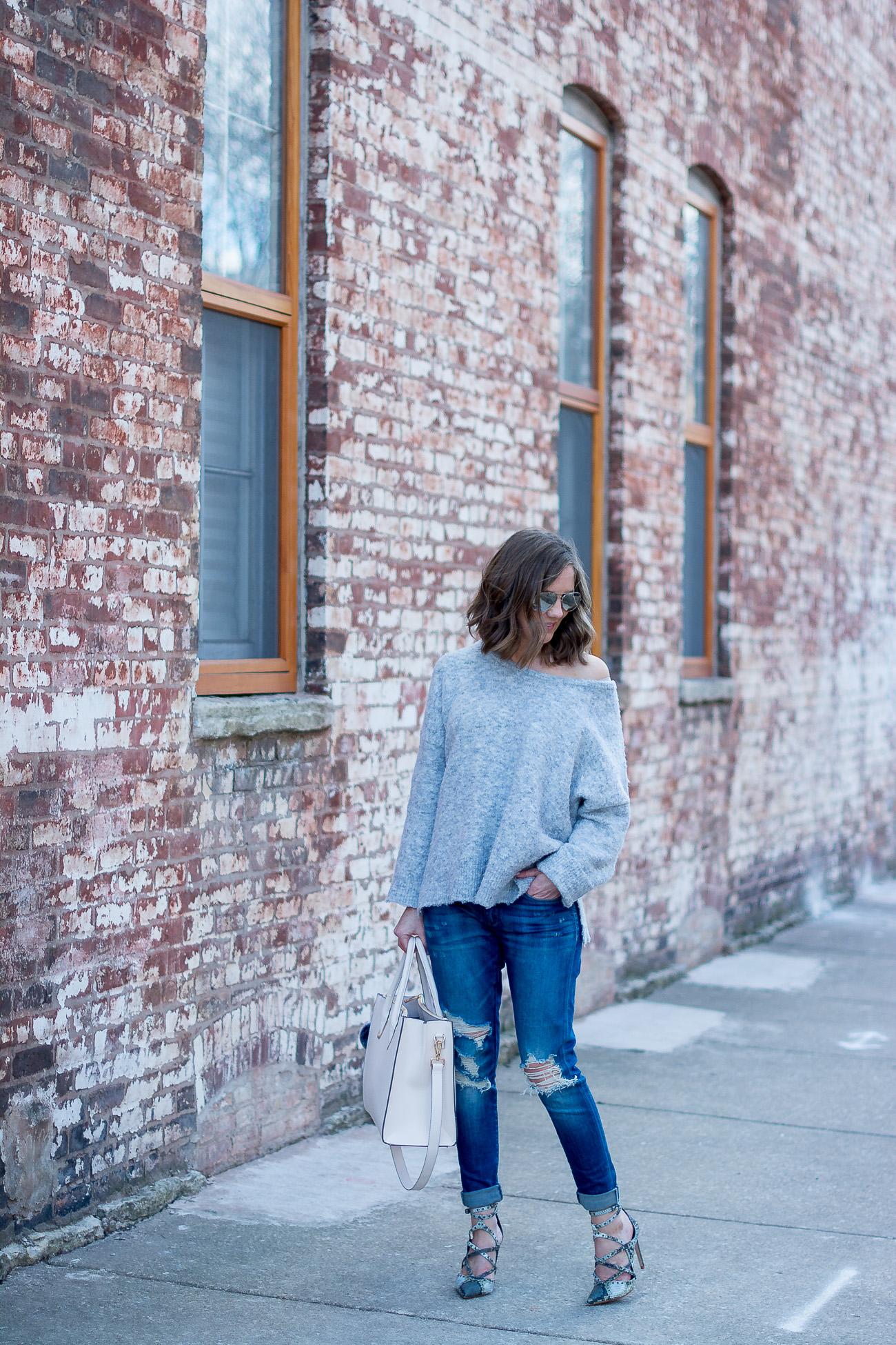 grey-off-the-shoulder-sweater-boyfriend-jeans-snakeskin-heels-blush-tote