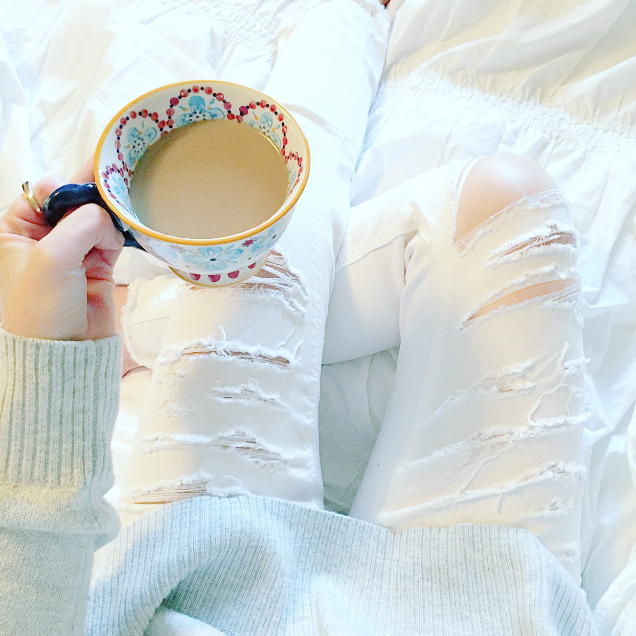distressed white jeans, Anthropologie mug, cozy in bed, Sunday morning
