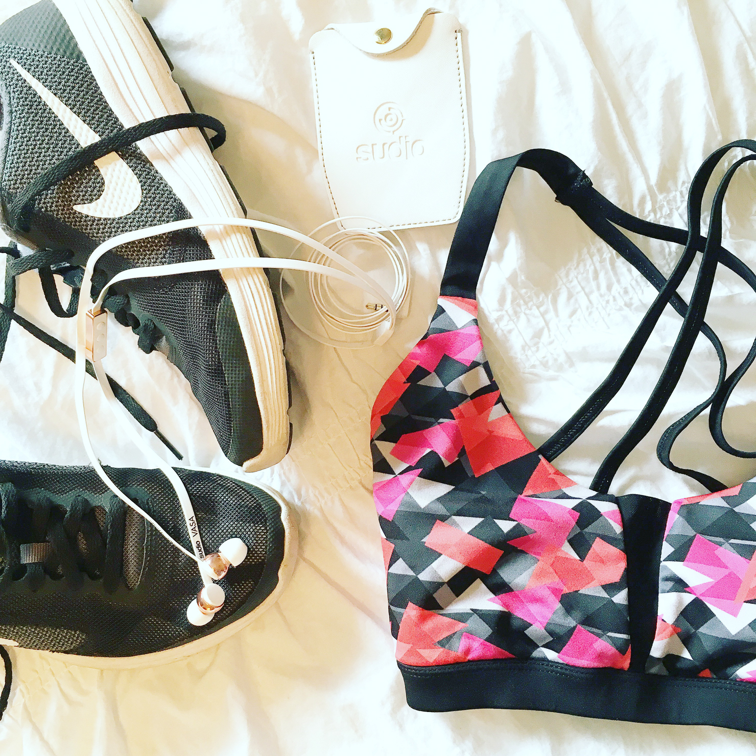 forever 21 sports bra, nike free running shoes, sudio headphones
