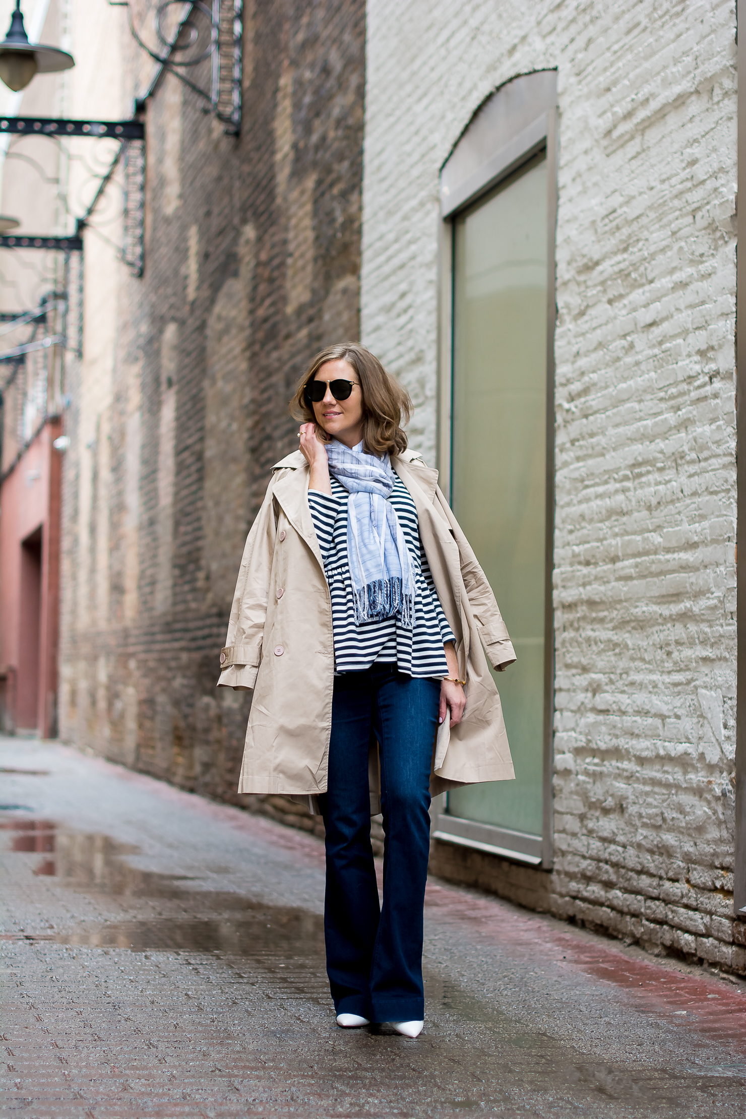 shein-blue-and-white-striped-peplum-jacket-high-rise-dark-wash-flares-trench-coat-white-pumps-h&m-blush-tote-rainy-day-spring-outfit