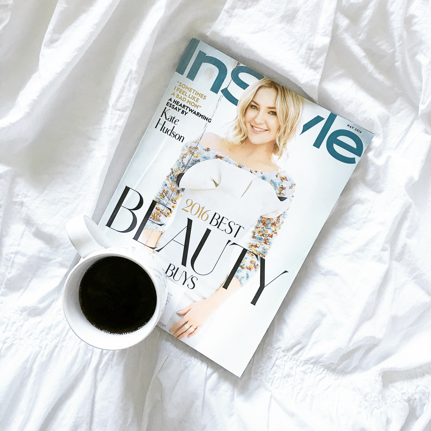 magazine-on-bed-with-coffee