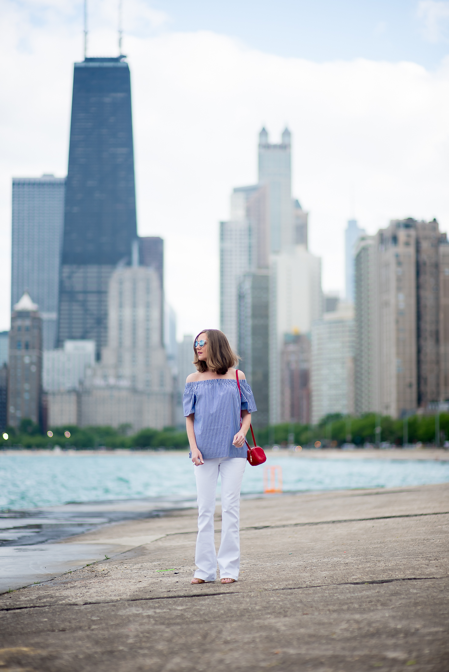 banana-republic-blue-striped-off-the-shoulder-top-white-flared-jeans-red-forever-21-crossbody-pouch-chicago-skyline-north-ave-beach