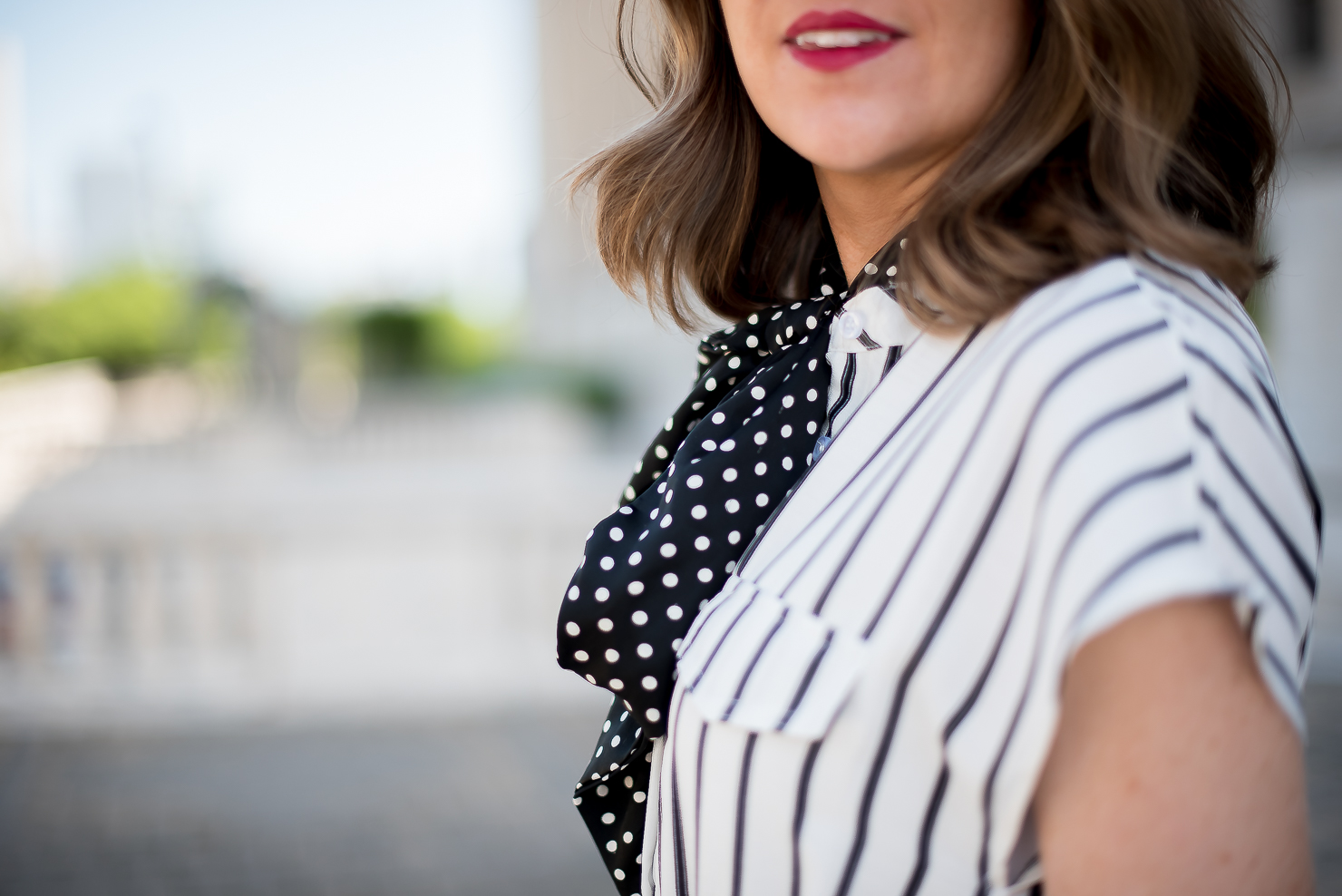 print-mixing-black and white striped dress with black and white polka dot neck scarf