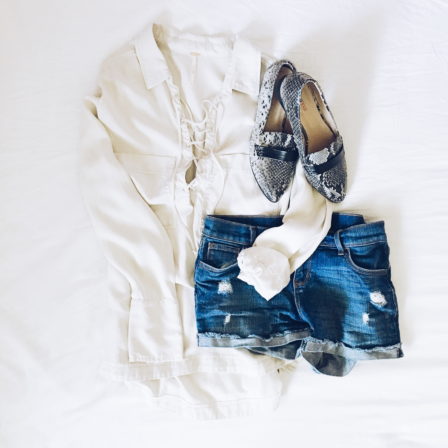free-people-under-your-spell-blouse-old-navy-distresed-cutoffs-justfab-snakeskin-flats