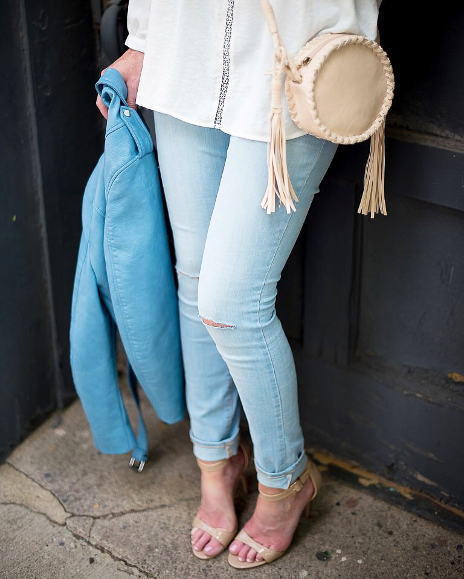 white-eyelet-blouse-light-wash-skinny-jeans-diy-jean rips-blue-zara-cropped-faux-leather-moto-jacket-tassel-canteen-bag