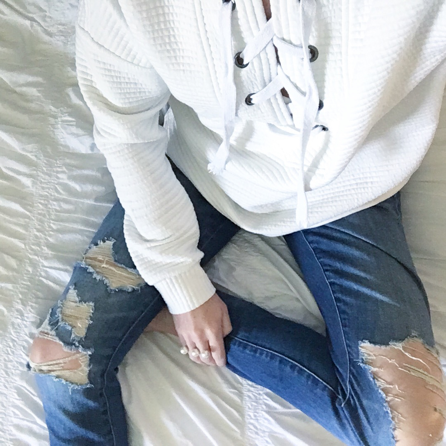 lace-up-sweatshirt-distressed-jeans