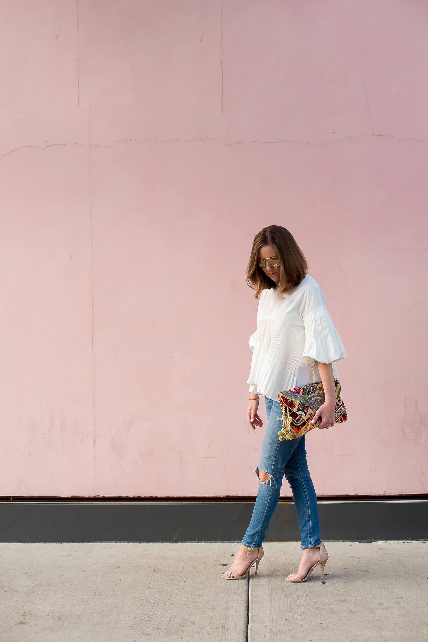 ruffled blouse-style-mafia-cecile-blouse-distresed-jeans-pink-wall-antik-batik-clutch-rose-gold-mirrored-aviators