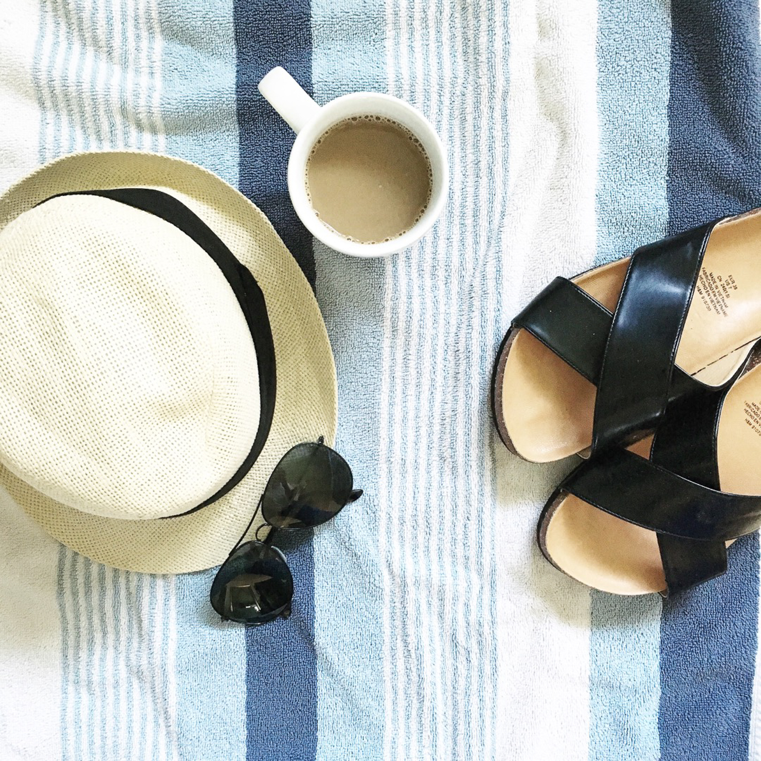 coffee-at-the-beach-hat-and-sunglasses-on-beach-towel-