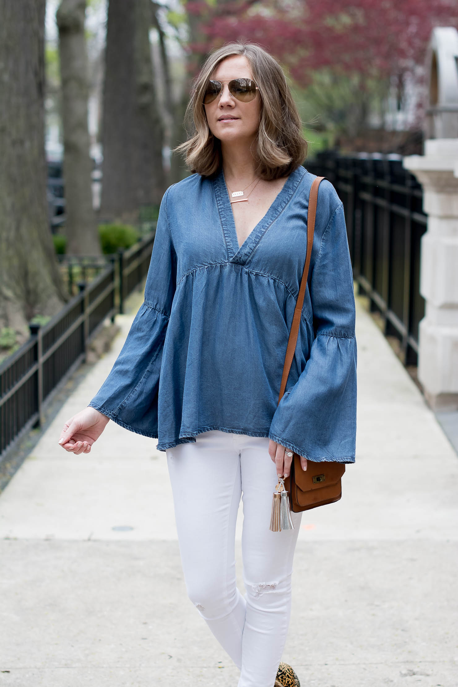e8d1ac80a01 transitioning-white-jeans-for-fall-hm-denim-bell-sleeve-top -matisse-leopard-booties-metallic-bag-tassel-charms-5