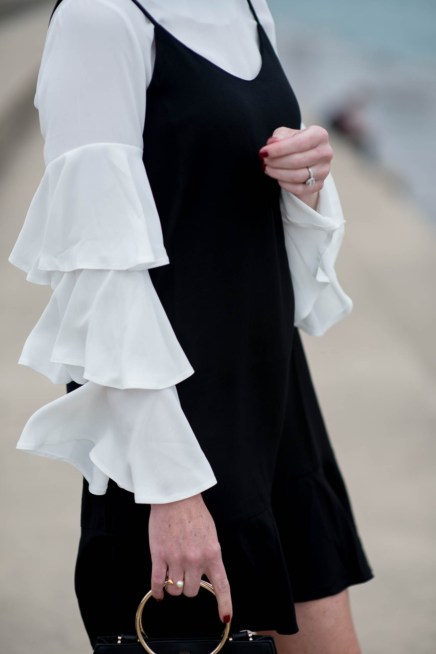 boohoo-ruffle-sleeve-blouse-asos-slip-dress-layered-ruffles-forever-21-round-handle-bag-black-and-cream