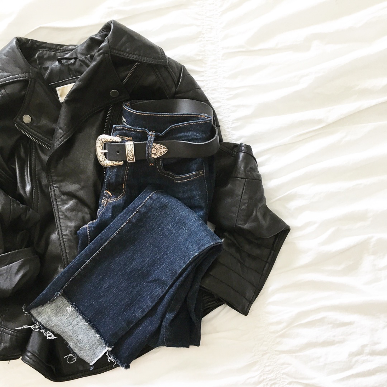 on-the-bed-shot-the-best-leather-moto-jacket-diy-raw-hem-jeans