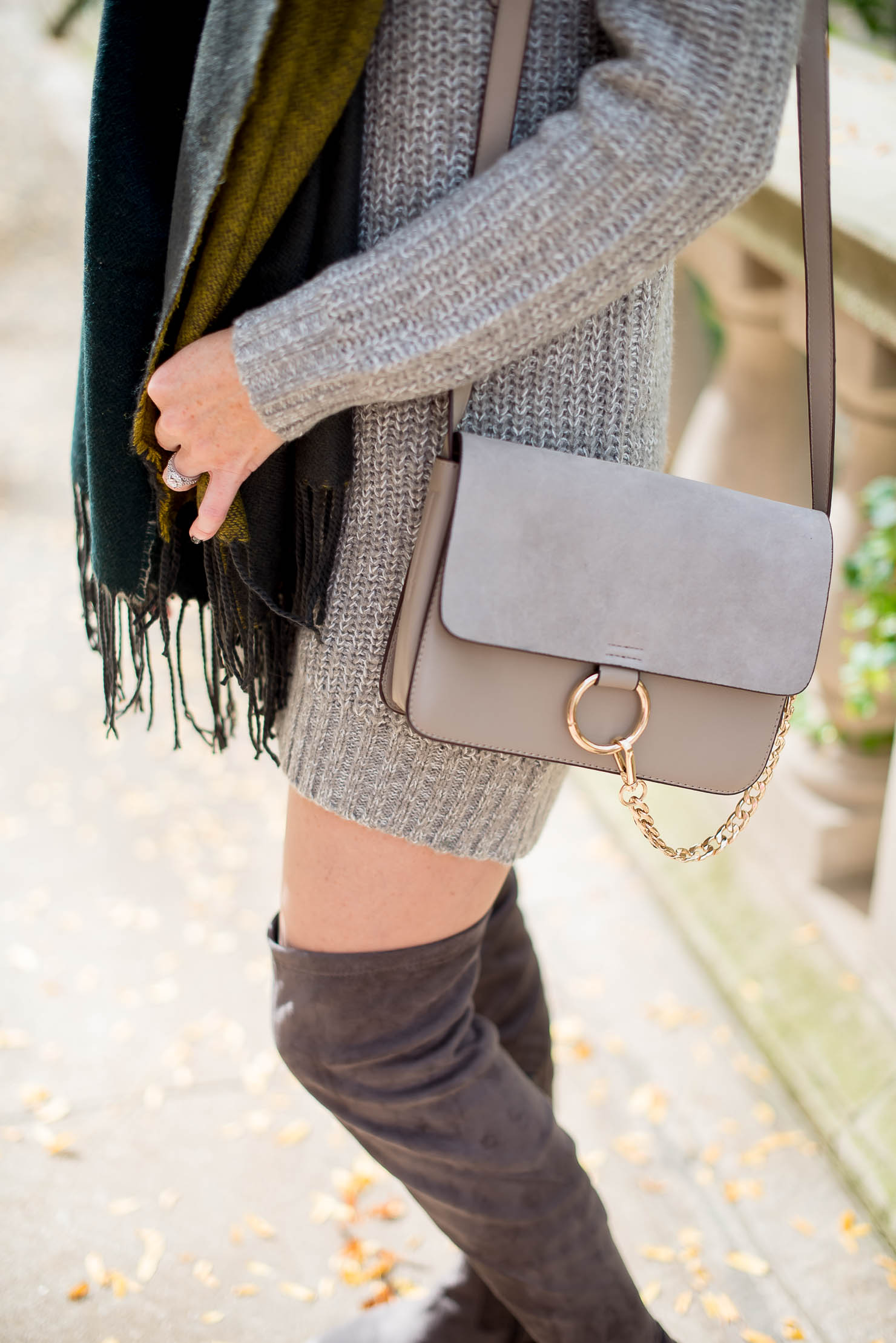 staying warm while looking stylish how to wear a sweater dress in the winter layering with secret silky hosiery open shoulder sweater dress