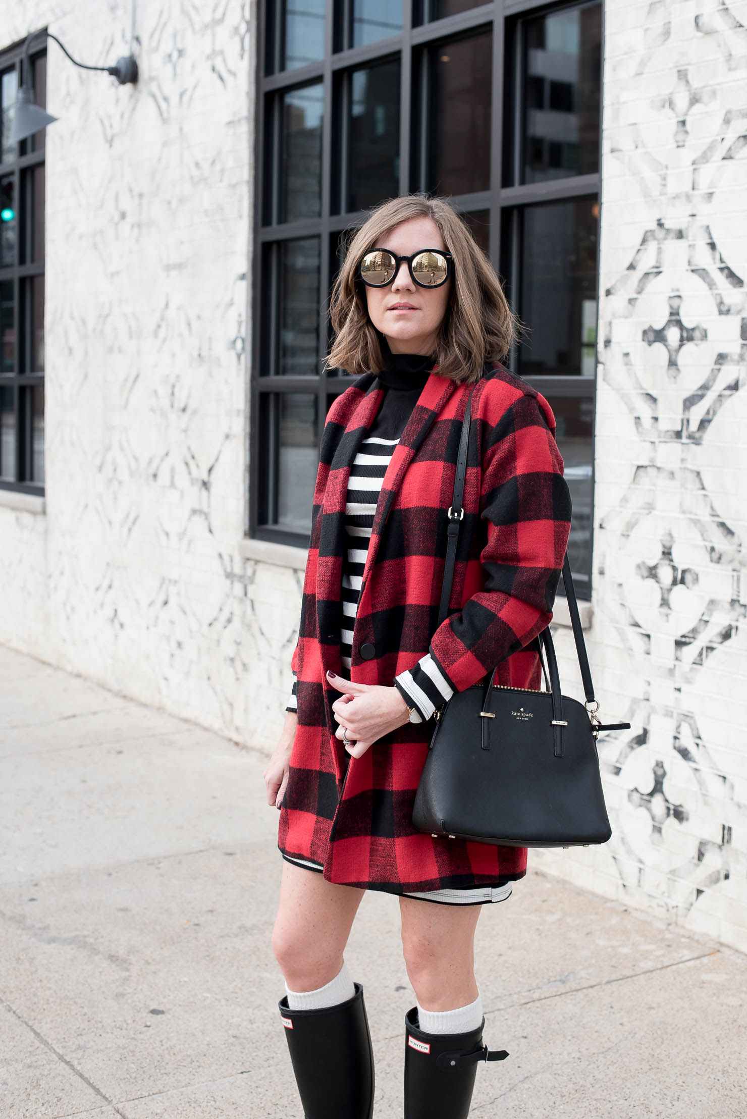 bc4cca25632 black-and-white-striped-mini-dress-and-red-buffalo-plaid-coat-with ...