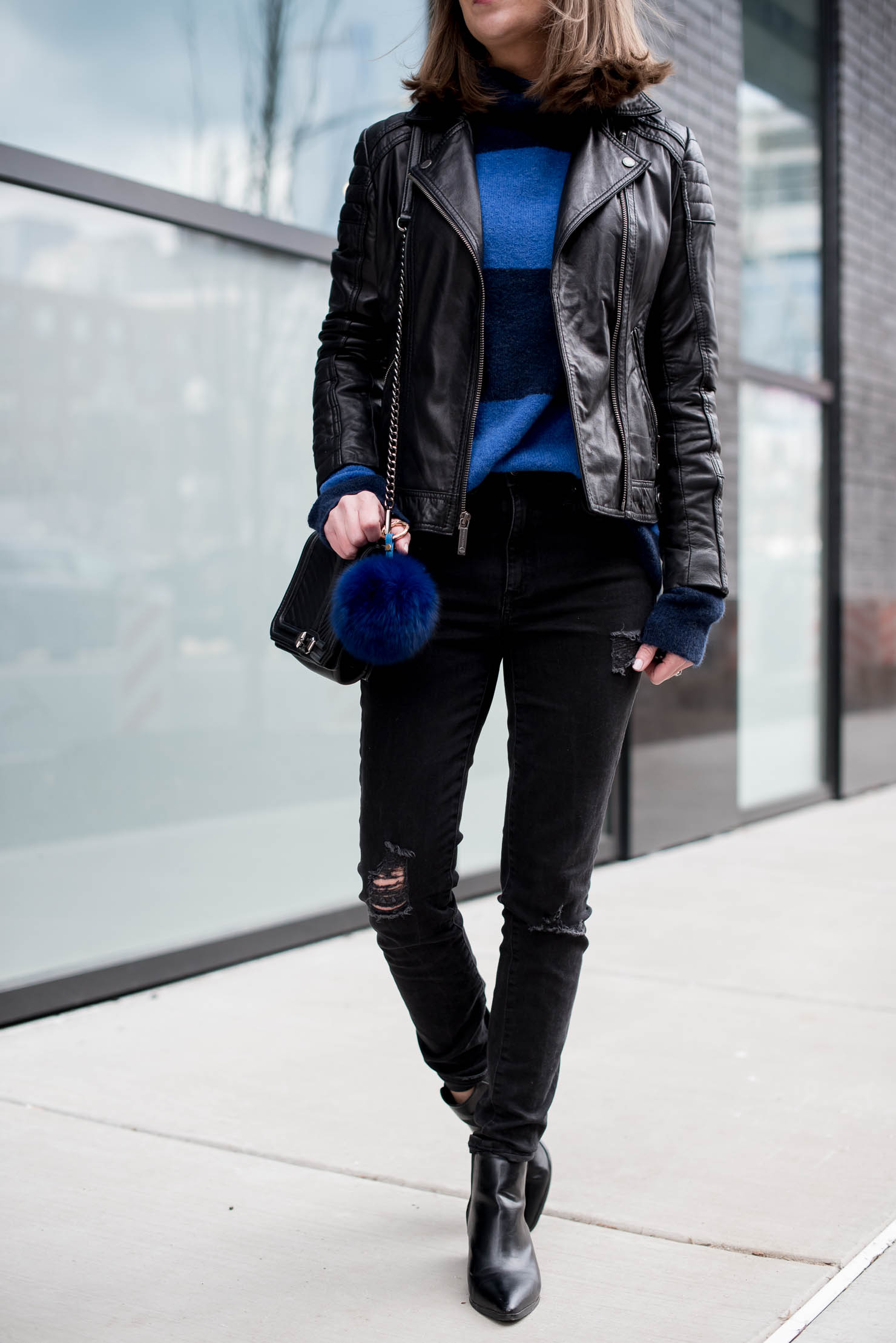 cozy spring outfit, black and blue look, styling the classic moto jacket