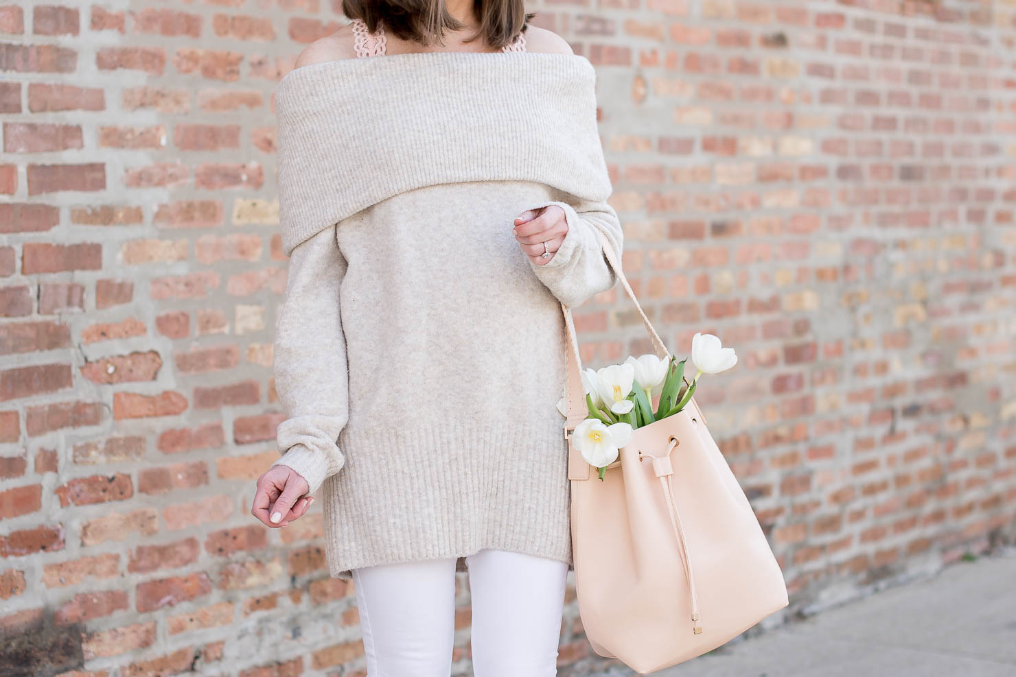 spring sweater, cozy spring style, light neutrals off the shoulder sweater, white jeans, blush bucket bag white tulips taking, your winter favorites into spring, the perfect nude heel for everyday