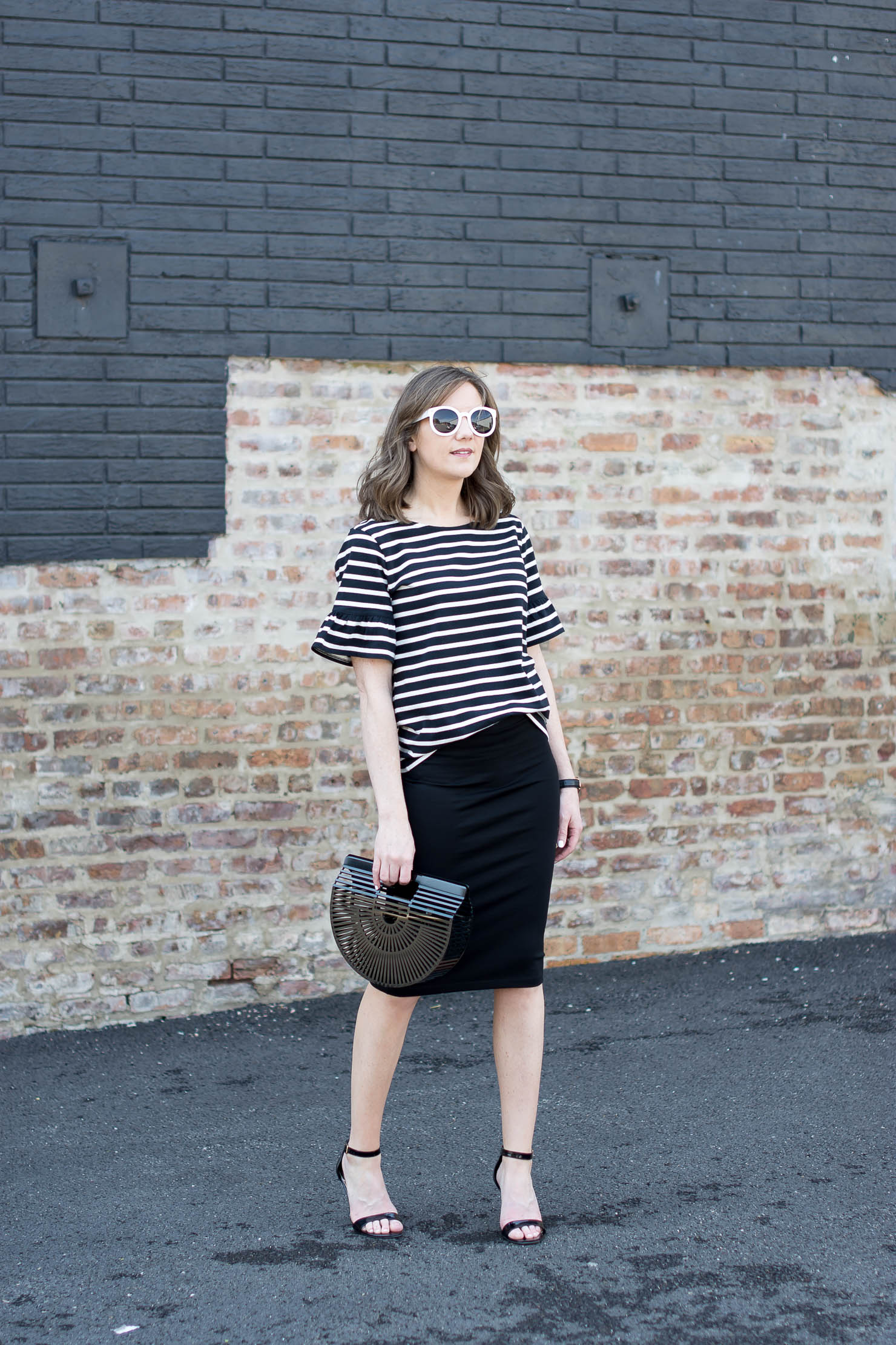 j crew black and white stripe ruffle sleeve tee, black zara pencil skirt, black acrylic cult gaia bag, white round sunnies, celine sunglasses dupe, black and white outfit