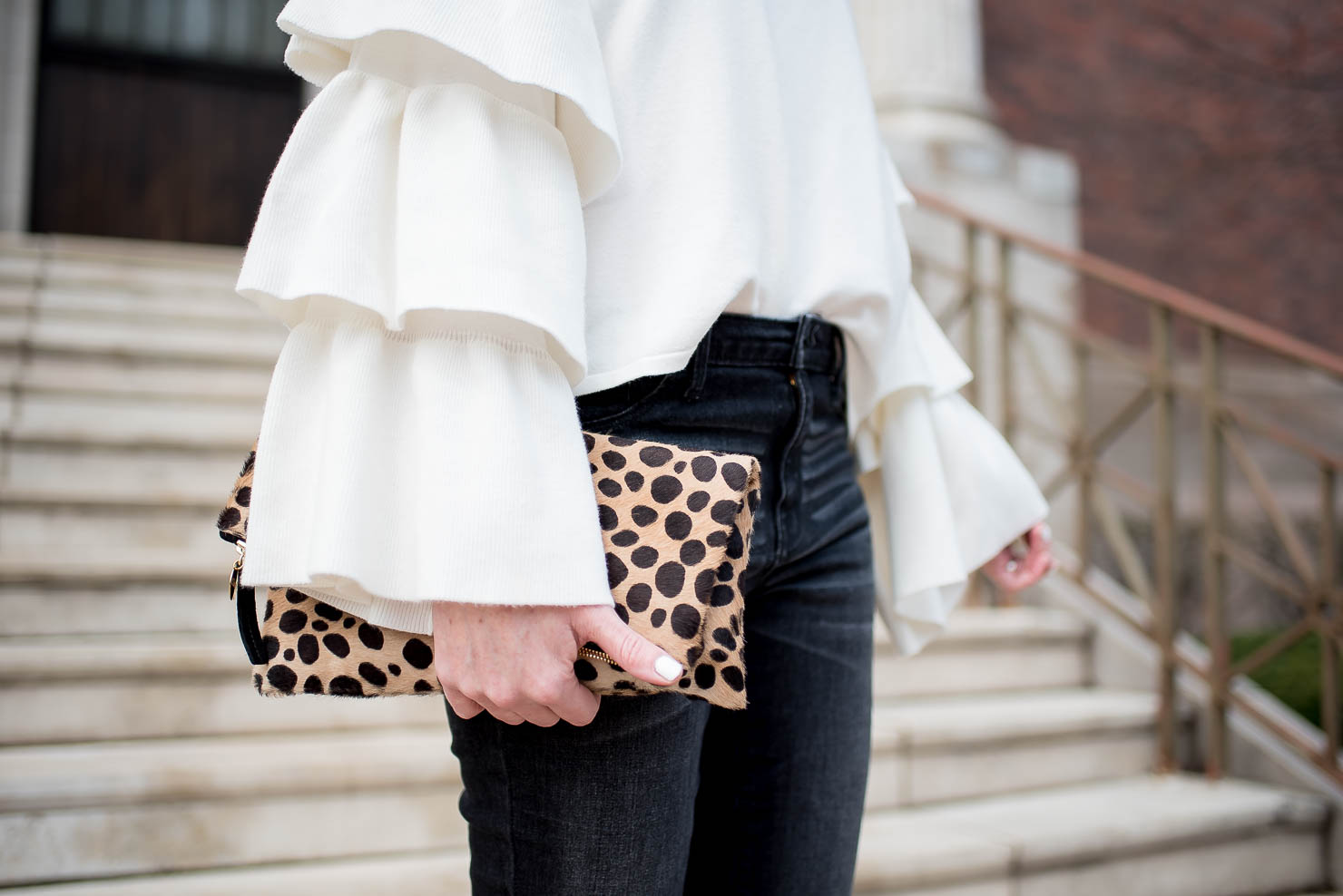 zara dramatic ruffle sleeve sweater, dark grey distressed jeans, leopard clutch, spring in chicago