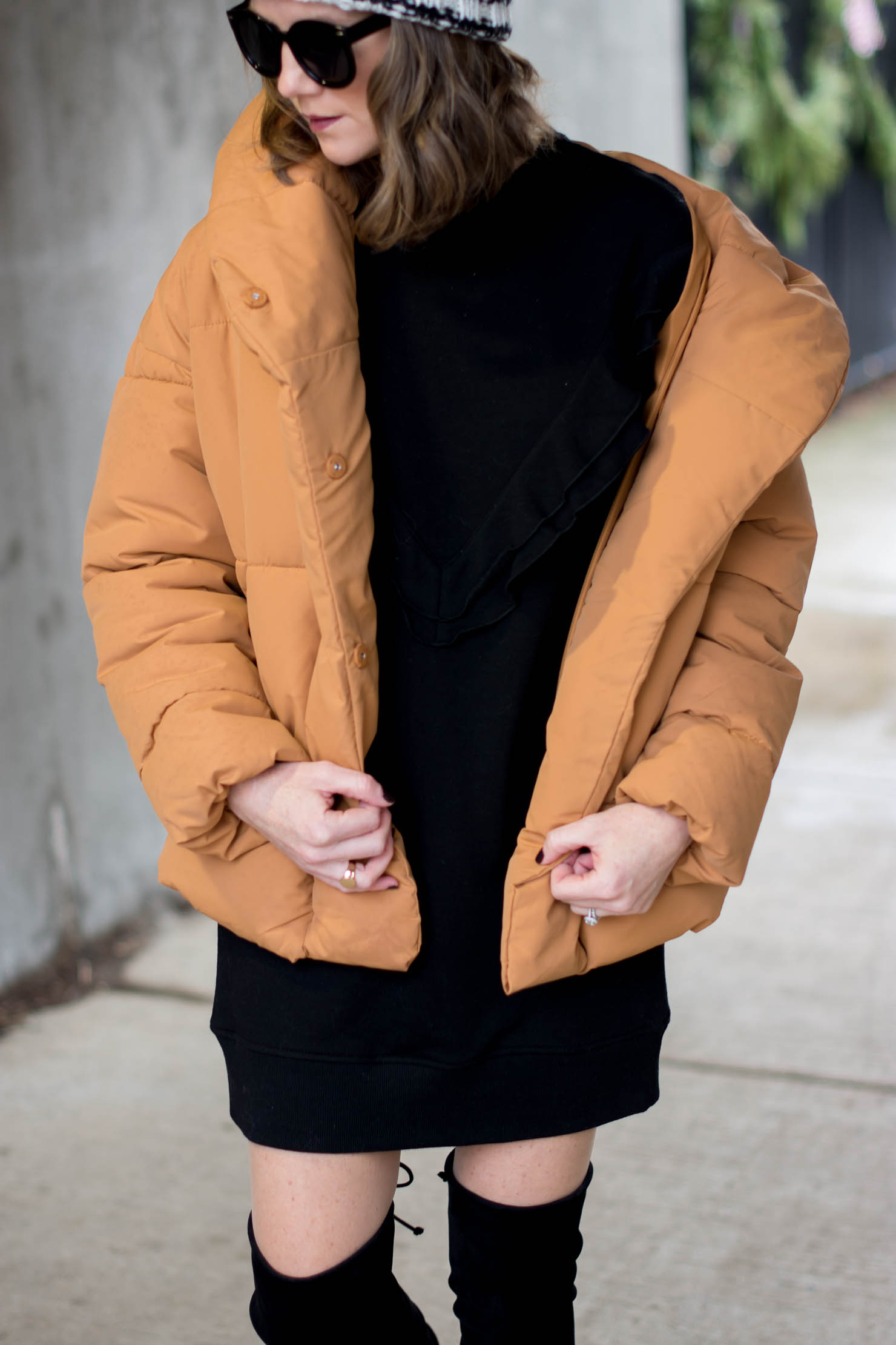 H&M mustard puffer coat, an updated puffer coat, looking cute in a puffer coat, how to style over the knee boots at midlife, a ruffled sweatshirt dress