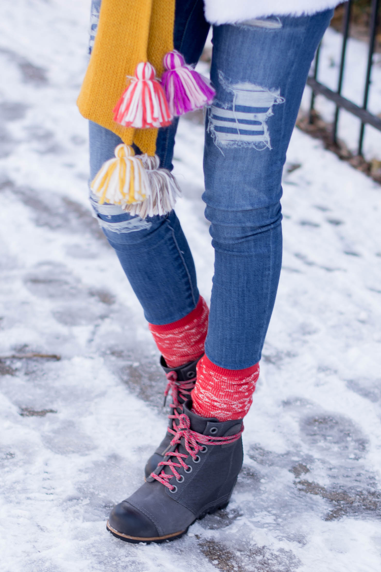 color block pompom scarf, white eyelash cardigan, sorel wedge snow boots, the chicest snow boots, looking cute and staying warm