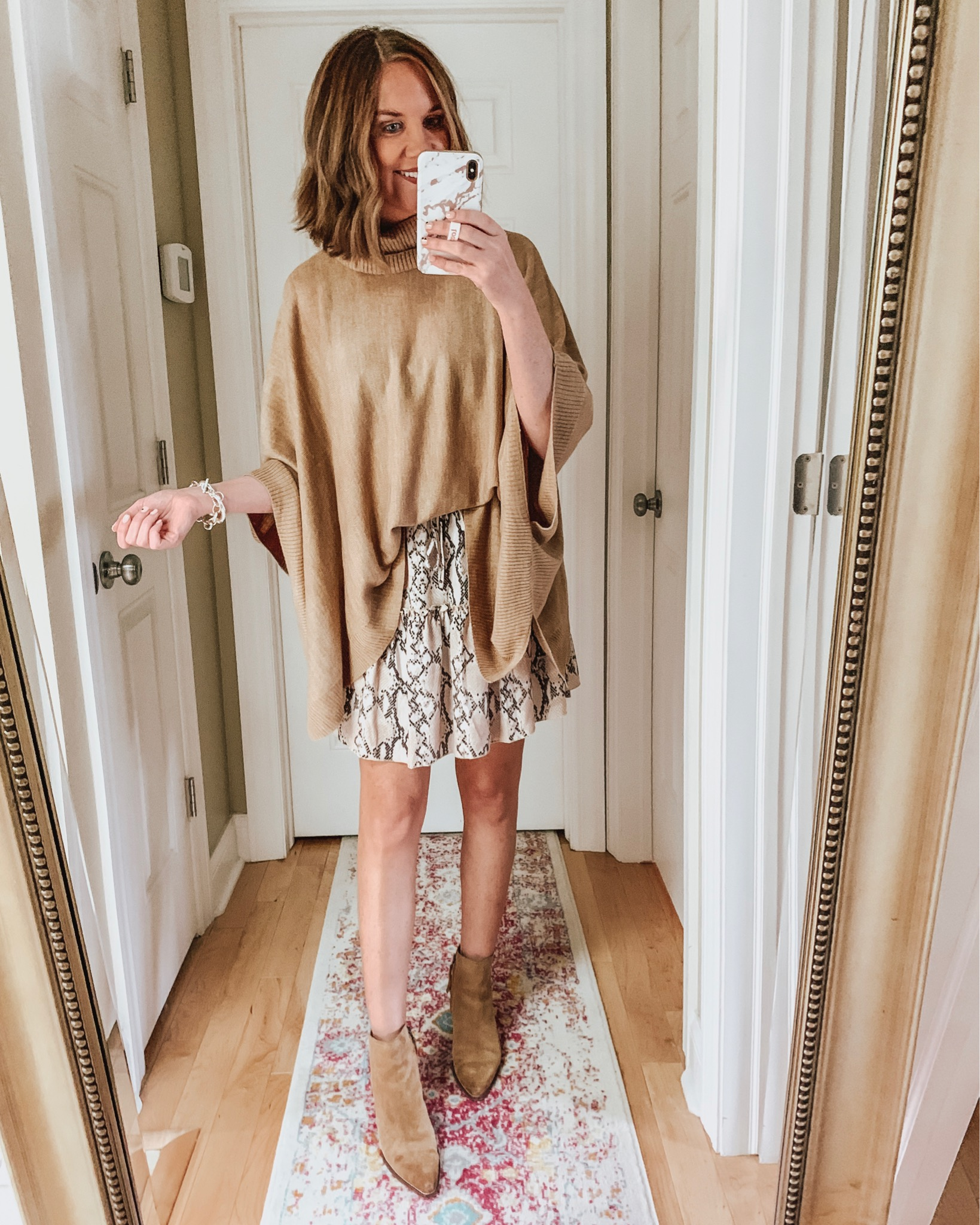 styling the Amazon mini skirt for fall, tiered skirt, poncho sweater, snakeskin print, booties, spotted skirt