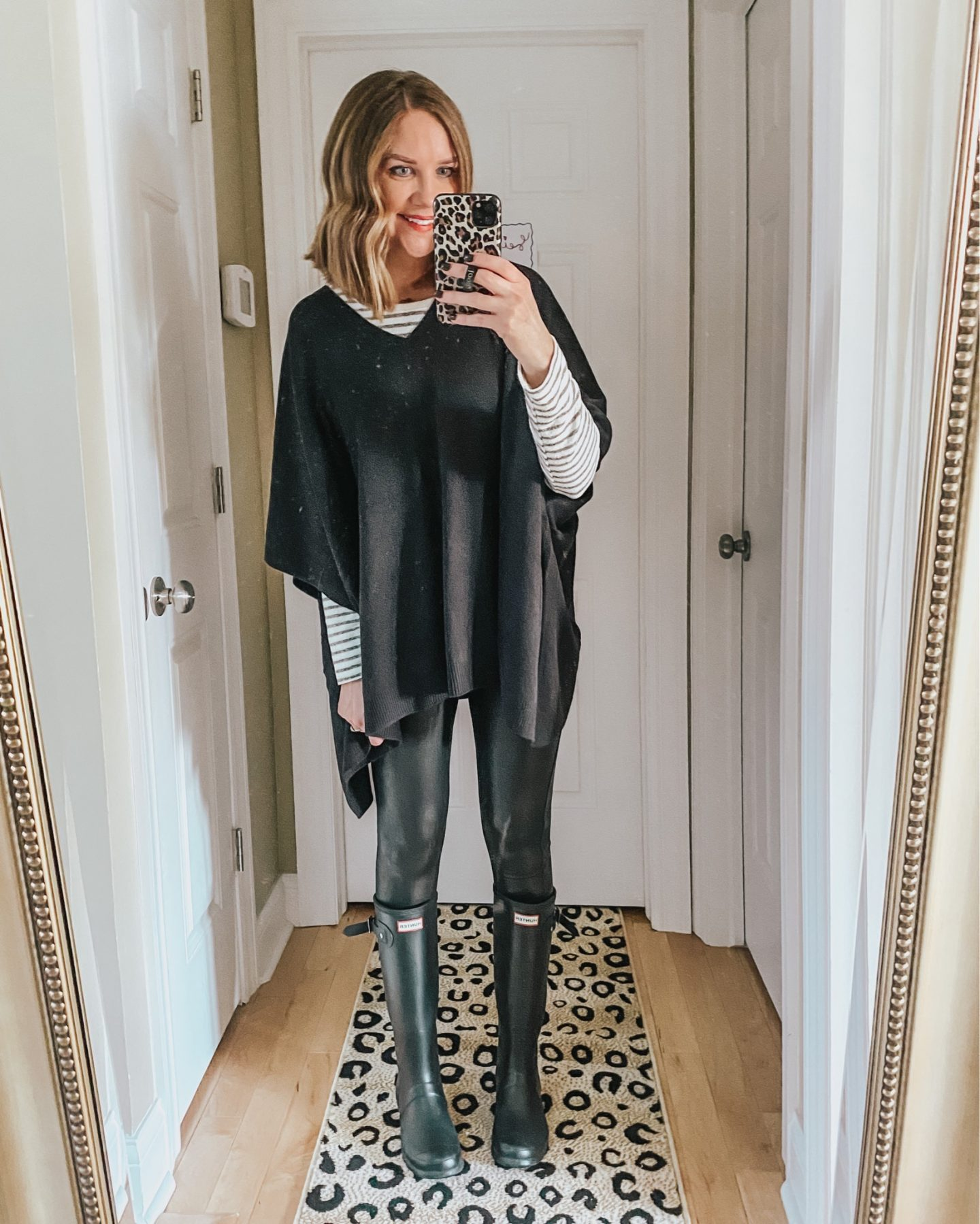 leggings-rain-boots-poncho-sweater-outfit