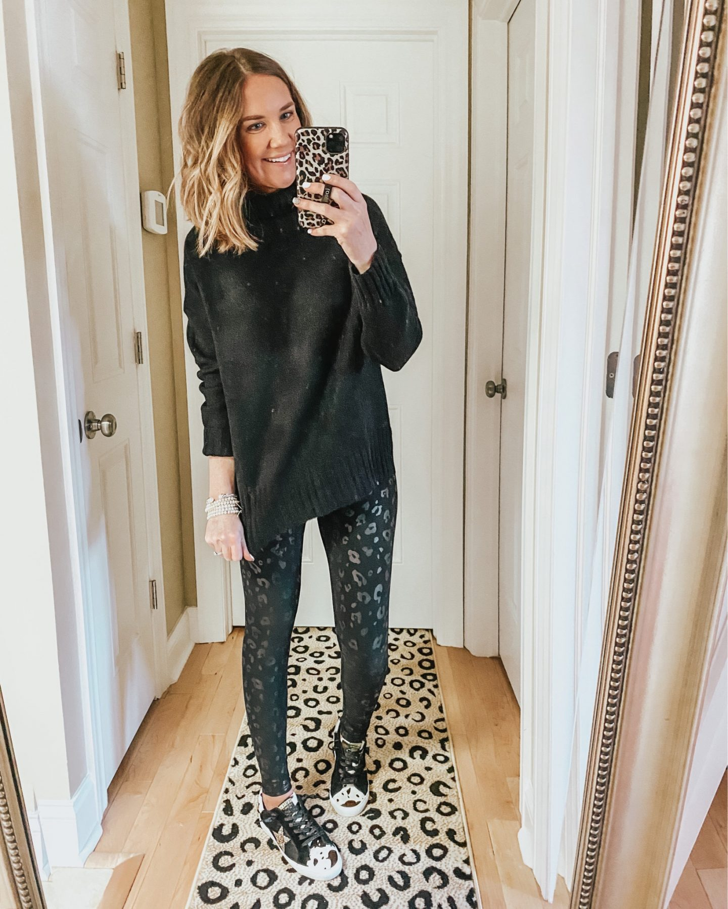 the best winter Amazon finds, black leopard leggings, cow print sneakers